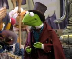 Characters and alter-egos assumed by Kermit the Frog in Muppet productions. Christmas Toys, Christmas Carol, Amy Mebberson, Sinbad The Sailor, What's My Line, The Poseidon Adventure, Muppets Most Wanted, The Ed Sullivan Show, The Hollywood Bowl