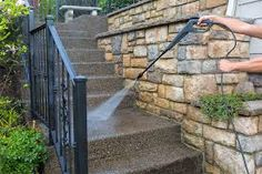 Photo about Washing the house front entrance stair steps and stone walls with pressure power washer. Image of tool, pressure, stone - 92501644 Clean Concrete, Concrete Steps, Pressure Washing Tips, Well Images, Photography Templates, Stone Walkway, Stair Steps, Front Entrances, Stained Concrete