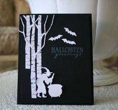 Halloween card...black with white die cuts...great arrangement of birch, bats and witch die cuts...