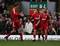 Liverpool's Peter Crouch celebrates with Lucas and Yossi Benayoun after Liverpool's third goal against non league Havant and Waterlooville 26 January...