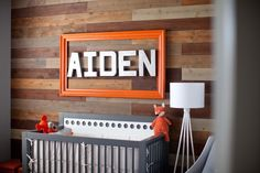 This urban den nursery is the perfect little man cave! An urban meets outdoorsman theme, this incredibly unique room features many DIY touches.