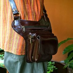 This compact Unisex Leather Crossbody Bag is a perfect travel companion. It features three organizing compartments and a long, adjustable