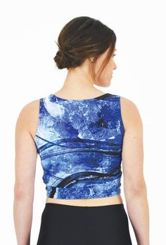 Arctic Flows – Fitted Crop Top // Axly // A vibrant Lapis Blue shattered ice texture complimented by cascading waves. Dare to pair with the Arctic Flows Leggings. 82% polyester / 18% spandex. Made in USA.