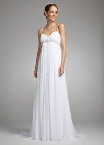 This ethereal beauty will turn every head in the room.   Beautiful crystal beading wraps around the flattering surplice bodice of this soft chiffon gown.  Pleats cascade down from the empire waist into a floor-length skirt featuring a sweep train to create an elegant silhouette.  Fully lined. Invisible back zip. Dry clean only.    Available in Ivory and White.  Available in sizes 14W-26W as Style 9SAS1228.