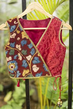 Just the coolest crossover tie blouse/croptop in maroon lace and Kalamkari! A very versatile blouse in a versatile color for a fresh take on a blouse.Endless pairing options abound…pair with any saree or skirt having maroon in it. Or just pair with a plai Choli Designs, Blouse Neck Designs, Kurta Designs, Blouse Styles, Indian Blouse, Indian Wear, Mirror Work Blouse, House Of Blouse
