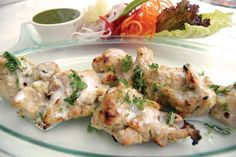Malai chicken tikka is creamy and soft. Many malai chicken recipes use hung curd for a thicker coating. However, thick malai is sufficient. This malai tikka recipe is easier and quicker than most. Try other kebab recipes on Cukzy. Karahi Recipe, Tikka Recipe, Chicken Reshmi Kabab Recipe, Tasty Indian Recipe, Indian Food Recipes, Wing Recipes, Malai Chicken Tikka, Urdu Recipe, Kottu Recipe