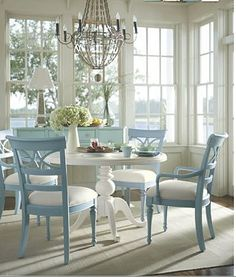 Old fashioned chairs painted blue with a white dining room table! I love it and can see my cherry traditional dining room set transition beautifully.