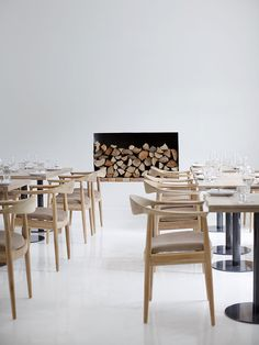The sparse white walls emphasising the grand space, with minimal furniture. Genius.