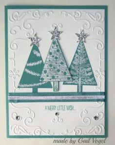 Love the white embossed, stamped trees on same color paper as background