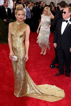 Like many other ladies, Kate Hudson opted for a gold Michael Kors dress with a crackled effect. It looks beautiful on her sculpted physique, but the loose tendrils around her face are distracting from her overall glamorous look.