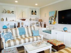 Nautical-Home-Decor-in-Contemporary-Family-Room-with-Sofa-and-White-Table-plus-Wall-Flat-screen-TV.jpeg (1280×960)