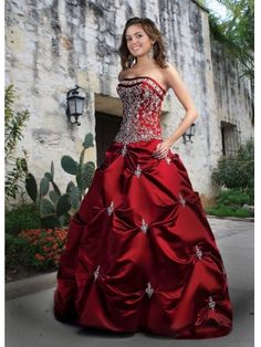 This is still the closest thing I've been able to find... it comes in white, silver, ivory.... but how much fun is this red?? This is listed as both a wedding dress and a Quinceanera gown.
