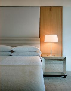 A #custom wood-and-linen headboard anchors the #bedroom.  #InteriorDesign: Rohrer Studio | See more projects at: http://www.HandD.com/DianneRohrer