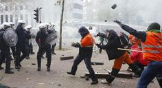 Riot police clashed with demonstrators in the Belgian capital of Brussels on Thursday amid a massive protest against government plans to reform the country's welfare system.   Anti-Austerity Protests Turn Violent In Belgium