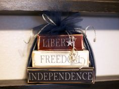 """I would add """"and God"""" .......   Great Patriotic decoration, wooden books in Red, White & Blue"""