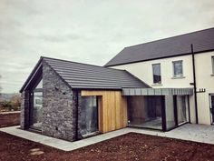 Another traditional home, with some modern tweaks, nearing completion. How do you like the combination of stone, timber and zinc? Modern Barn House, Modern Bungalow, Timber House, Model House Plan, House Plans, House Designs Ireland, Dormer House, Farmhouse Architecture, Farmhouse Renovation