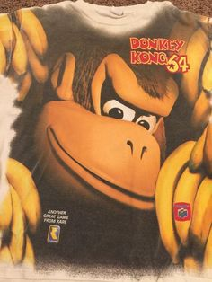 Donkey Kong 64 Nintendo 64 rare special promotional graphic T-shirt 1999. Vintage Size says one-size-fits-all it is a large shirt measurements from Pitt to pit 24 inches length top to bottom 30 inches. Made from 100% cotton Excellent condition | eBay!