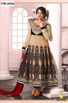 Take cream, black and red length anarkali Salwar suit beautified with embroidered and patch lace border work.