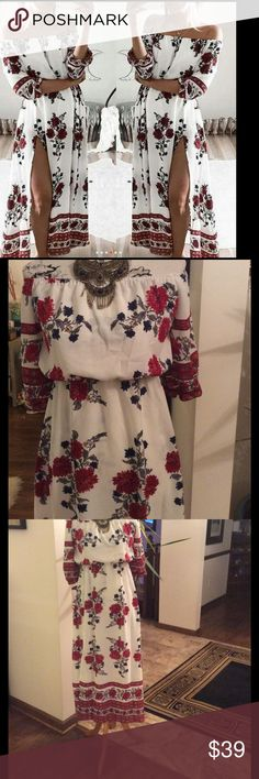 Ethnic Floral Maxi dress Printed floral border moss crepe fabric white ground red flowers and navy accents . Elastic off the shoulder neckline with left leg off center split Dresses
