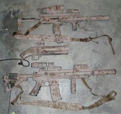 "OBL raid load out. ""My primary weapons: a Heckler & Koch MP7 with suppressor (top); a highly modified M79 40mm grenade launcher, a.k.a. the ""pirate gun"" (middle); and a Heckler & Koch 416 assault rifle with a ten-inch barrel and suppressor (bottom)."""