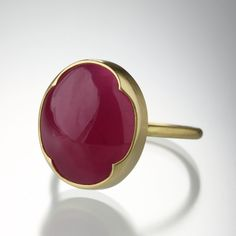 Sometimes Simple is Best an 18K Yellow Gold Full Round Band with a Large Milky Pink Rubelite in a Scalloped Bezel Setting.