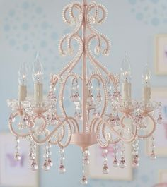 How pretty  in a little girls bedroom.  Such a pretty pink chandelier http://rstyle.me/n/gi45hnyg6 Great chandeliers on this website