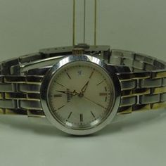 """Tissot """"Classic Dream"""" two tone ladies watch, mother of pearl face, model T033/21A, date display, Swiss, Quartz, fold over bracelet 18cm, water resistant 30m, with COA  http://www.lloydsonline.com.au/LotDetails.aspx?ItemID=332515  #jewellery #auction #pawn #gold #quality #luxury #diamonds #rings # #watches #art #collectibles #goldjewellery #luxury #value #auctionhouse #pawnbank #lloydsonline #online #estatejewellery #vintage"""