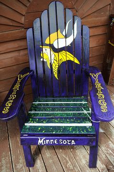 "Description of . A chair titled ""Skol Vikings!"" by Mike Dodge and Katsy Hansen  sits in front of Shafer Saloon & Grill in Shafer, Minnesota....  (Slide show of painted chairs)"