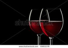 Red wine in glass on black background close up - stock photo
