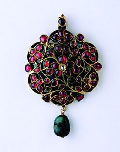 Gold pendant set with rubies, emeralds, and diamonds. South India, 19th century. Indian jewelry from the Susan L. Beningson collection