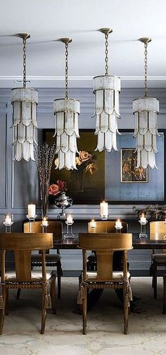 Decidedly femme Art Deco pendant lights hung at staggered lengths to stand, en masse, in place of a traditional chandelier.:
