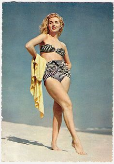 All wrapped up in bold black and white stripes. #vintage #beach #summer #swimsuit #model #1950s #bikini