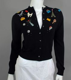 Schiaparelli Embellished navy Sweater that added a decorative touch to the displaying of the upper half of the body.