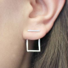 Square Ear Jacket, Silver Earrings, Sterling Silver, Ear Jackets, Square Wire Earrings, Bar Studs, Earrings, Studs, Minimal Jewelry, Silver  Unusual, quirky and irresistibly cool, these on trend sterling silver bar ear jacket earrings can be worn 2 ways for a bold and modern statement.  Wear just the stud for a wearable daytime look, or add the jacket for an eye-catching addition for the evening.  Simply insert the stud into the ear, followed by the round jacket and butterfly back…