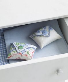To make a sachet, cut a four-inch square from a hankie. With the pattern side up, fold three corners toward the square's center. Hand-stitch the sides together. Turn the sachet inside out, press, and sew a decorative button atop the flap. Fill the pouch with dried lavender, then secure the flap with some hidden hand-sewn stitches.