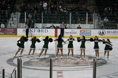 Bemidji State hockey cheerleaders performing a pinwheel.
