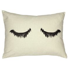 "Cream canvas throw pillow with an eyelash design. Product: PillowConstruction Material: Canvas and polyester fillColor: Cream and blackFeatures: Sealed closureInsert included Dimensions: 16"" x 12""Cleaning and Care: Dry clean only"