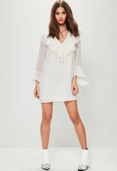 Let's get frilly with it wearing this shirt dress - featuring a flared sleeve, frill neck and contrasting stripe.