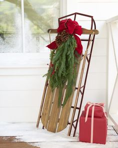 Add a nostalgic touch to your home décor with the Holiday Hill Decorative Sled.