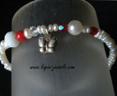 Hand made bracelet of fresh water pearls,coral and silver 925 butterfly.Μade by Eirini Svarnia Price 35.00 euro