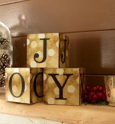 Personalize a set of photo cubes for the mantel this holiday season. Sparkle and shine with custom home decor. | #ShutterflyHoliday