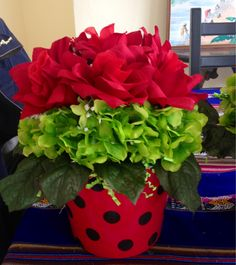 Great Idea. Lady Bug centerpiece for tables. Lady bug Garden Birthday Party.