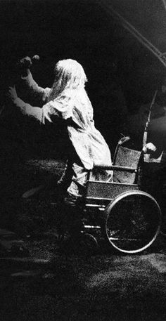 """Kurt Cobain opening the show live at Reading with Bette Midler's """"The Rose"""" during his famous 'wheelchair stunt',1992."""