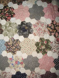 Antique English pieced hexagon quilt top.