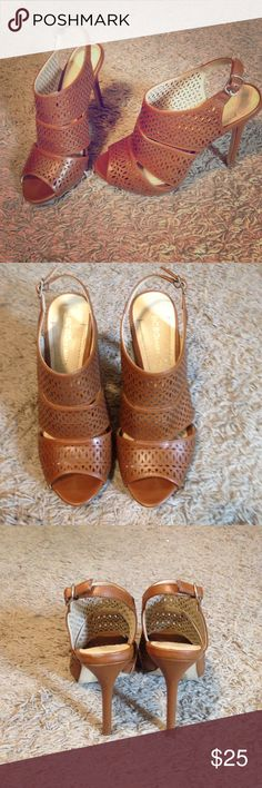 BCBG heels sz 6 Very hot and trendy heels! Cognac color with cutout pattern  4 in heels. Worn twice, so great condition! Sz 6 BCBGeneration Shoes Heels