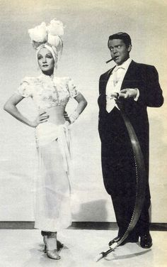 Orson Welles and Marlene Dietrich. Welles looks like he doubts Dietrich's saw playing ability!
