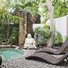 Awesome Backyard Garden With Tropical Landscape With Small Pool And Big Concrete Buddha Statue