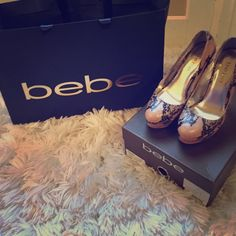 Snake skin Bebe shoes Bebe shoes. Perfect condition. Tan and black. Round front. High heel with platform. Comfortable. Still has original box. bebe Shoes Heels