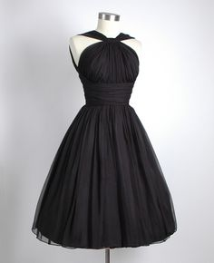 1950's black gathered sheer chiffon party dress with a halter-like neckline and open back...