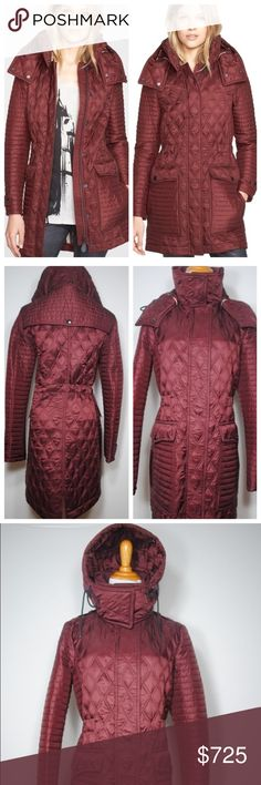 """Burberry Brit Bosdale Burgundy Coat Like new condition. A mix of channel and diamond quilting topped with a tall knit-lined stand collar for neck-warming comfort. A detachable hood adds versatile weather protection while dual-entry oversized pockets keep hands cozy and gear safely stashed. An interior drawstring at the waist keeps the look trim and shapely. 32"""" length (size Medium). Hidden front zip/snap closure. Detachable hood. Snap-tab cuffs. Woven check quilted lining, with 100%…"""